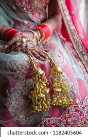 Indian bridal showing wedding mehndi design and Kalire bangles