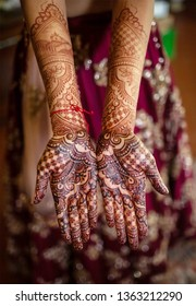 Indian bridal showing wedding mehndi on her hand