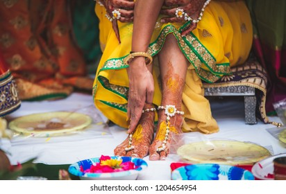 Indian Bridal ubtan haldi pasting for foot Mehndi ceremony