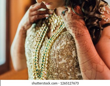 Indian Bridal wearing necklace jewelry and showing wedding mehndi design Karachi, Pakistan, December 20, 2018