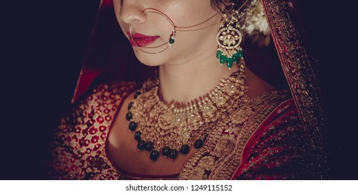 Indian bridal wearing nose ring and necklace jewelry on her wedding day Karachi, Pakistan, December 03, 2018