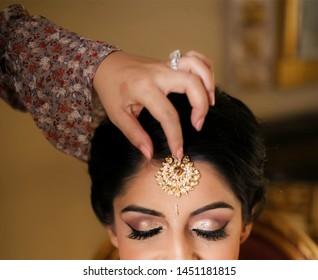 Indian bridal wearing tikka jewelry Karachi, Pakistan, 05, July 2019