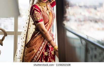 Indian Bridal wearing wedding sari and Gold necklace jewelry