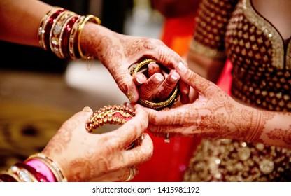 Indian bride getting her wedding bangles