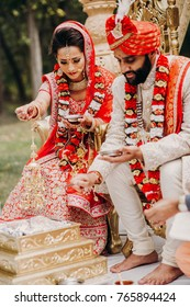 a1ade73a57db9 Indian bride and groom dressed in traditional shewrani