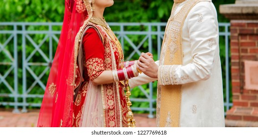 Indian bride and groom holding hands after the wedding ceremony