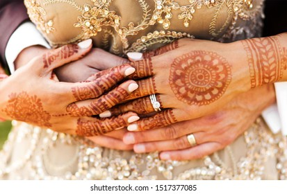 Indian bride and groom holding hands at their ritual ceremony