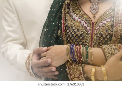 Indian bride and Groom holding hands after getting married