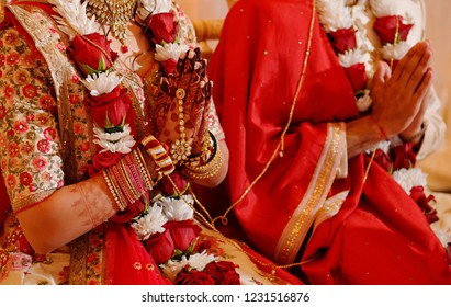 Indian Bride and groom praying poja riutal ceremony