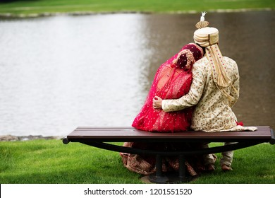 Indian bride and groom treasured moments and wearing red Sharara, sharwani