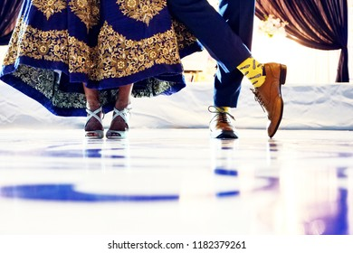 Indian bride and groom's showing wedding footwear shoes and sandals