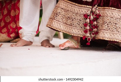 Indian Bride performing ritual by touching grinding stones with her feet toe Islamabad, Pakistan, 01 August 2019