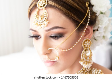 Indian bride preparing for her wedding ceremony with bright jewelry and detailed garments