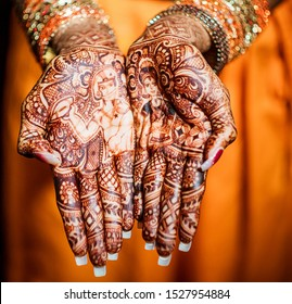 Indian bride showing hand mehndi design and wedding bangle