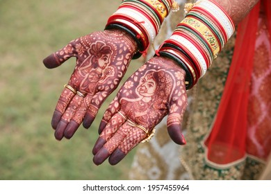 Indian bride showing hands with henna