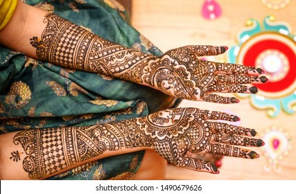 Indian bride showing hands mehndi design