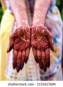 Indian bride showing mehndi tattoos design