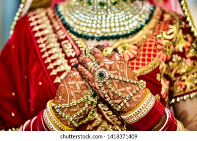 indian bride and the tradition of red colour and jwellery