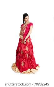 Indian Bride wearing red bridal gown isolated on white.
