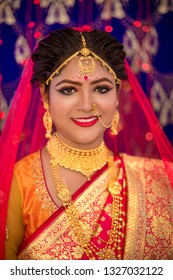 Indian bride wearing traditional dress and gold jewellery . Traditional Indian bride in hindu wedding.