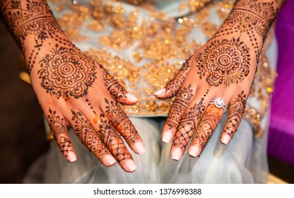 Indian bride's showing mehndi design and wedding ring