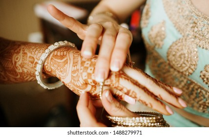 Indian Bridesmaid for helping bride putting the bangles