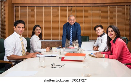 Indian Business / Corporate culture and People Working in the office Concept with Laptop, papers, meetings, presentations and discussions