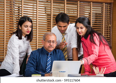 Indian Business / Corporate culture and People Working in the office Concept with Laptop, papers, meetings and discussions