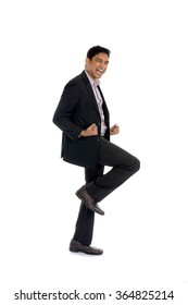 indian business male jumping in joy