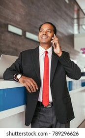 Indian Business Man Calling on Phone at Reception