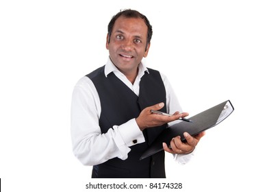 Indian business man with folder and pencil