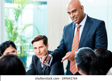Indian Business man leading team meeting of diversity people in office
