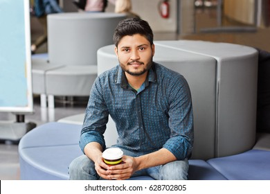 Indian business man on coffee-break with cup of coffee