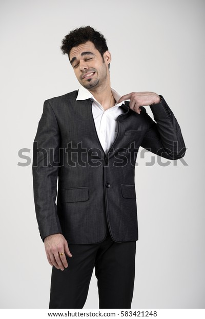 Indian Business man pulling collar feeling suffocated