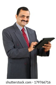 Indian business man using tablet, isolated on white background.