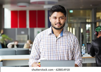 Indian business man working on laptop sitting on th table