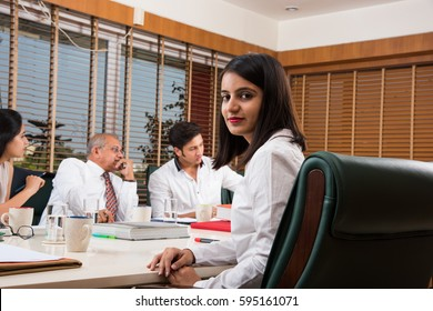 Indian Business People / Corporate culture and Working in the office Concept with Laptop, papers, meetings, presentations and discussions