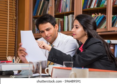 Indian Business People / Corporate culture and Working in the office and Teamwork Concept with Laptop, papers, meetings, Cel phones, presentations and discussions
