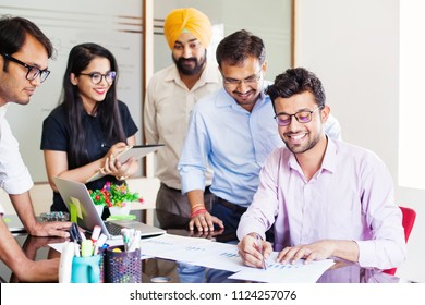 Indian business team working together in office