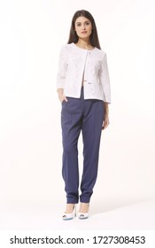 Indian business woman executive posing in white jacket and blue trousers