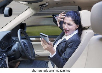 Indian business woman having a car accident caused by using a mobile phone while driving