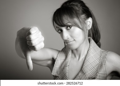 Indian business woman posing in studio isolated on a background, black and white image