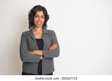 indian business woman smiling with plain background