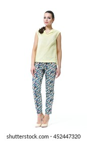 indian business woman with straight hair style in summer print trousers and sleeveless top  high heel shoes full body length isolated on white