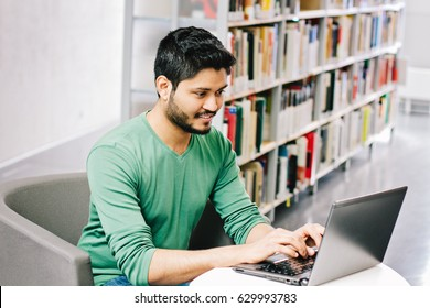 Indian businessman in casual outfit working on laptop