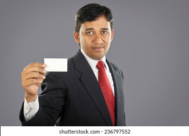 Indian businessman showing business card