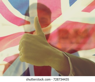 Indian Businessman Showing Thumbs Up, Double Exposure with Union Jack British Flag, Close up Shallow Depth of Field Split Toning Haze Photography