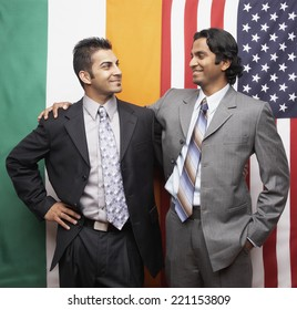 Indian businessmen in front of flags