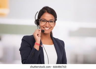 indian businesswoman with headphones