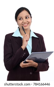 Indian businesswoman holding a laptop computer